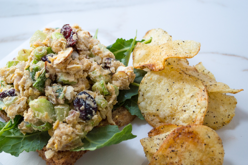 Chickpea Salad Sandwich full of fresh scallions, celery, nuts and cranberries with a nutty tahini dressing. | cookinginthecreek.com