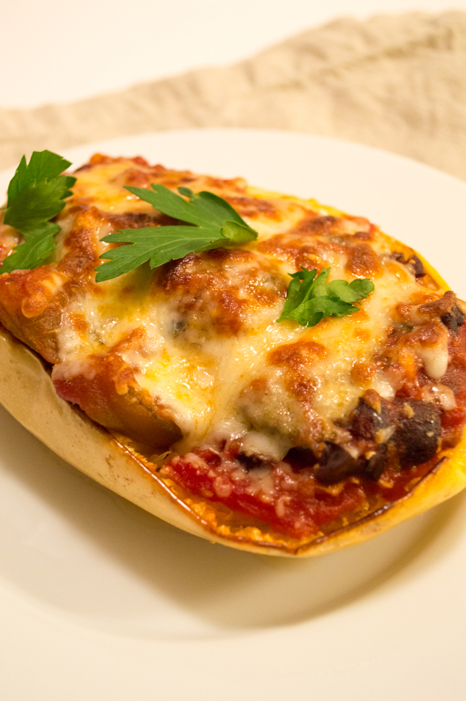 Roasted spaghetti squash, home-made marinara sauce, with chunks of roasted eggplant, kalamata olives, and melted cheese. | cookinginthecreek.com