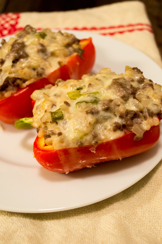 Enjoy this easy to make stuffed bell pepper dish filled with the meat of your choice, rice, sour cream, onions and topped with melted cheese. | cookinginthecreek.com