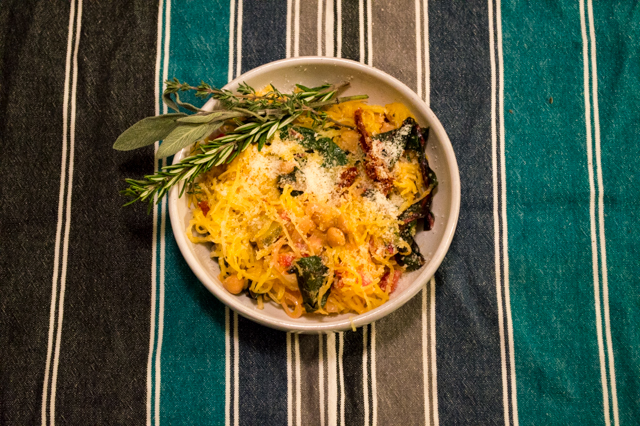 Roasted spaghetti squash sautéed with rainbow swiss chard, chickpeas, sun dried tomatoes and topped with parmesan cheese. | cookinginthecreek.com