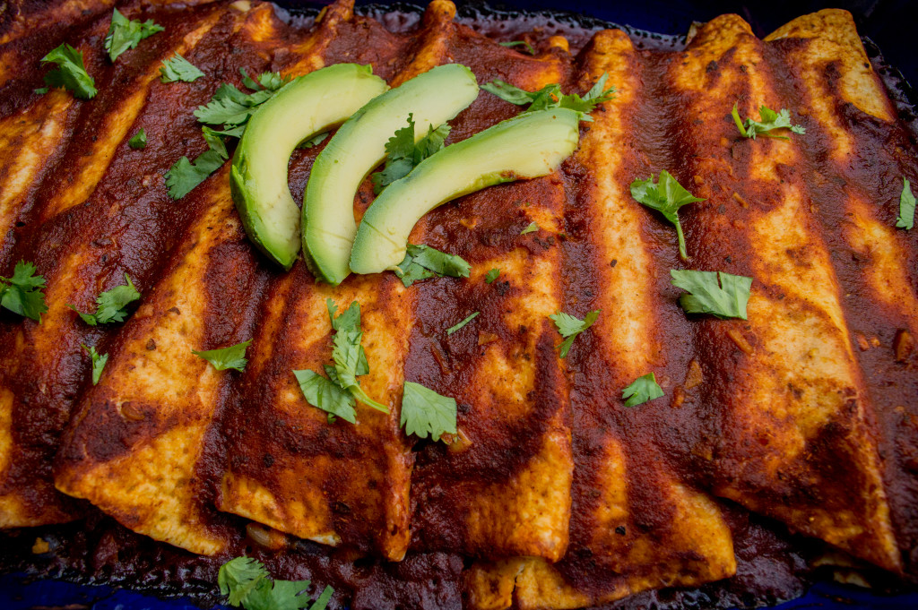 Sweet Potato, Squash, & Black Bean Enchiladas. They are packed with yummy vegetables and legumes, and vegetarian and vegan friendly. | cookinginthecreek.com